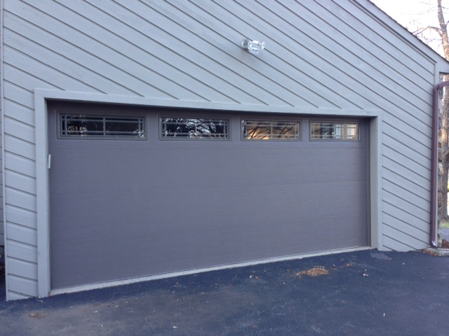 Suburban overhead doors inc 610 565 4140 for Clopay steel garage doors